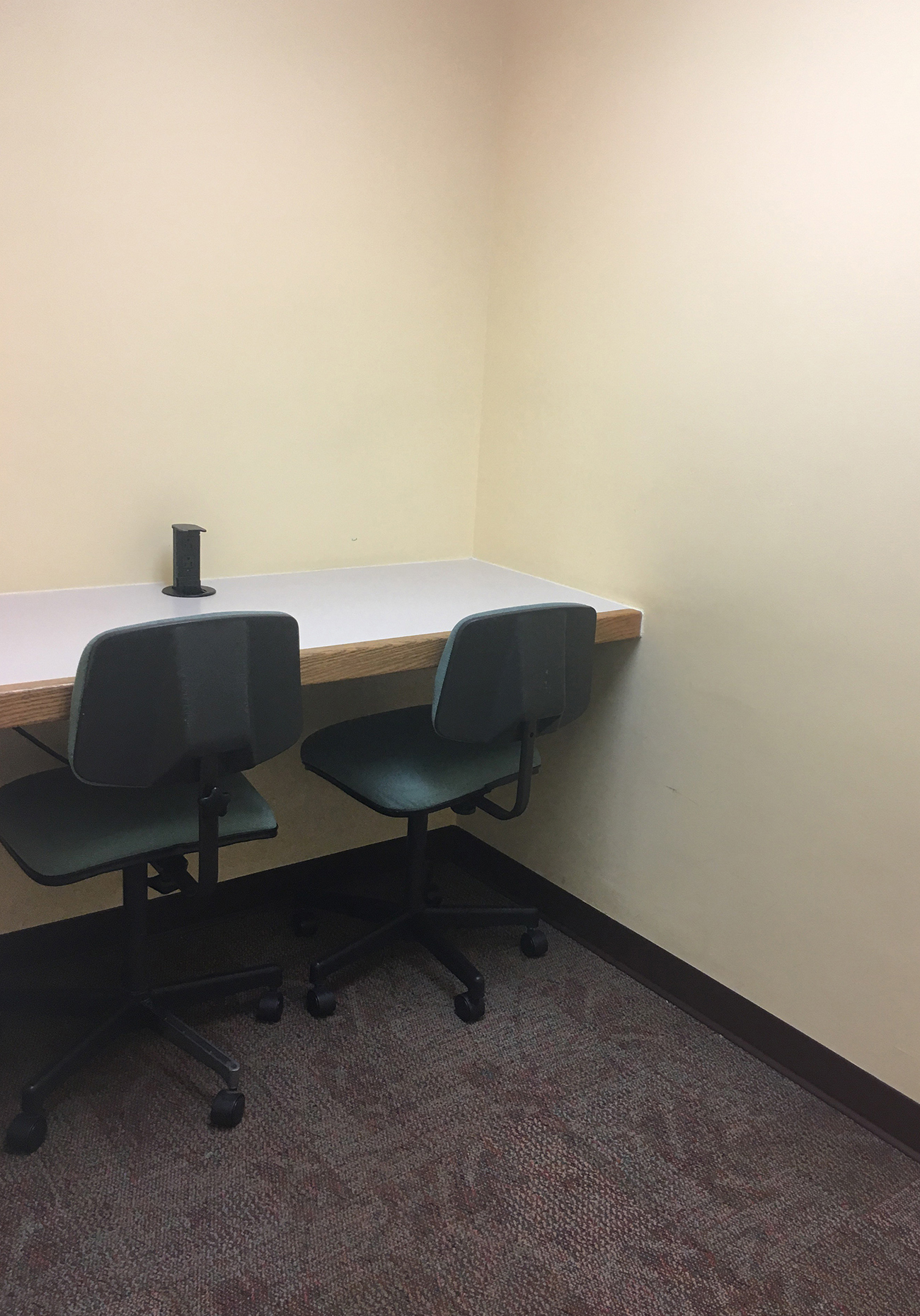 Small study room with two chairs and table