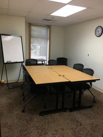 Conference style layout with white board