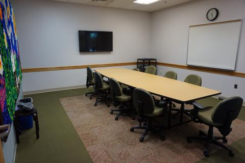 Finksburg small meeting room with a rectangular table and conference-style seating, television and white board mounted on wall