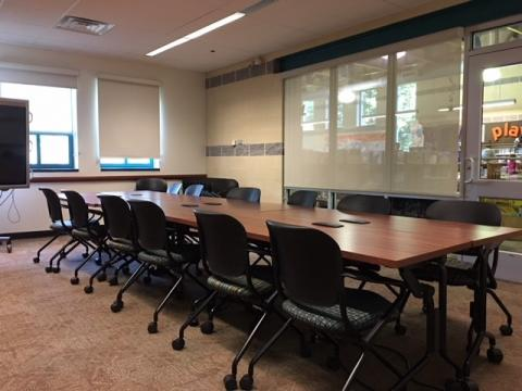 Mount Airy small meeting room with a long rectangular table and conference-style seating